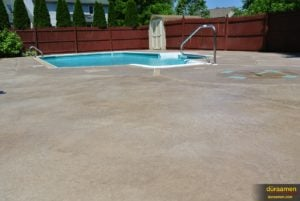 This large concrete patio near the pool has been resurfaced with Uberdek, a concrete resurfacing product from Duraamen.