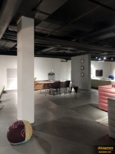 The gallery retailers space comes to life with the modern concrete flooring.