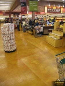 The checkout section of the Hudson, Ohio Heinens shown with Concrete Microtopping, Skraffino was used and subsequently dyed with DESO dyes.