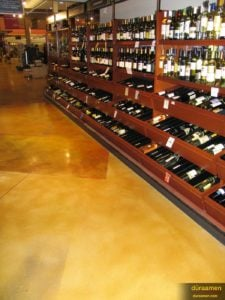 The wine section of Heinen's stained with shades of tan and orange, sealed with water based epoxy and polyurethane.