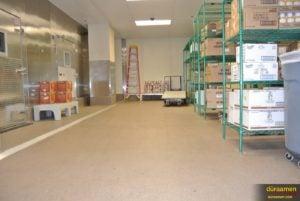Heavy equipment and shelves of food sit atop this decorative quartz flooring in Cleveland, Ohio.