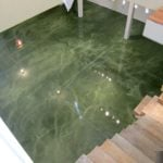 This building entrance has had it's flooring enhanced with a striking green color using metallic epoxy.